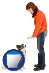 arkansas map icon and a woman training a pet dog