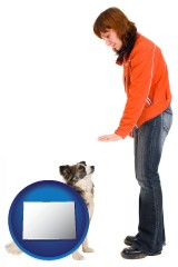 colorado map icon and a woman training a pet dog