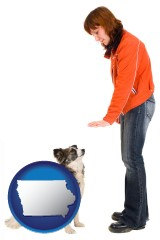 iowa map icon and a woman training a pet dog