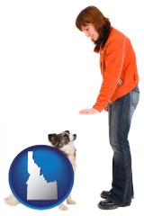 idaho map icon and a woman training a pet dog