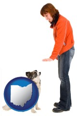 ohio map icon and a woman training a pet dog