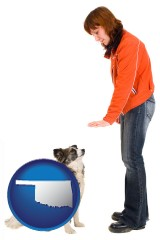 oklahoma map icon and a woman training a pet dog