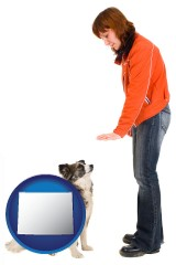 wyoming map icon and a woman training a pet dog